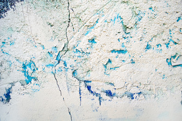 The texture of the painted wall. Background of cracked paint, points, deffects.