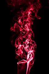 Wall Mural - Red smoke isolated on black