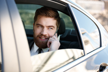 Image of Smiling Business man talking on phone