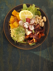 Bowl of Buddha. Vegetarian food, millet, beans and raw vegetables