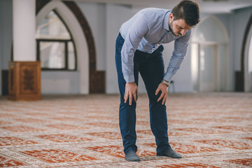Muslim bowing in prayer, close up shot