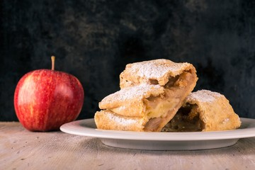 Two portions of apple strudel with sugar