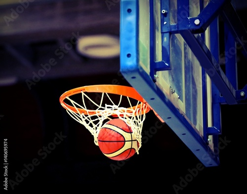 great shooting and basketball going into the basket stock photo and
