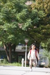 Girl with backpack running