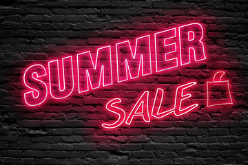 SUMMER SALE. fluorescent Neon tube Sign on dark brick wall. Front view. Can be used for online banner ads or background. night moment.