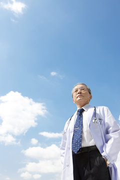 Male Doctor Against Sky
