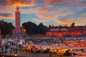 Famous Jemaa el Fna square crowded at dusk. Marrakesh, Morocco