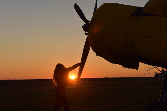 beautiful female pilot getting the airplane ready to fly