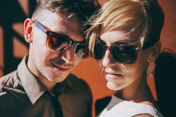Portrait of a couple wearing sunglasses