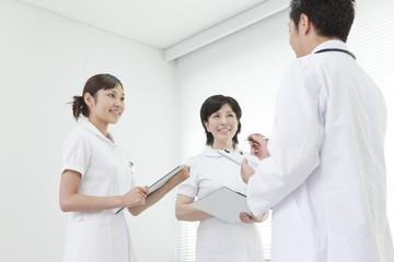 Doctor talking to nurses