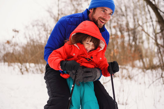 Father teaching his daughter to ski