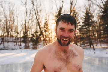 Portrait of a shirtless man in winter after running through water sprinkler