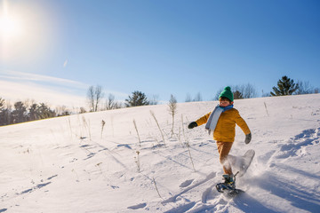 Boy snow shoeing on snow