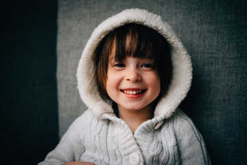 Portrait of smiling young girl with hood