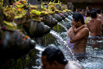 Man washes his face at Tirtha Empul water temple