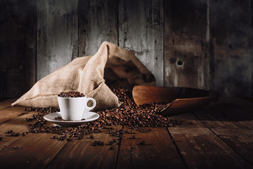 Photo sur Aluminium Salle de cafe Background of cup of coffee beans