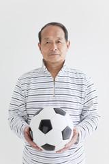 Senior man with soccer ball