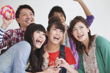 Young people singing karaoke