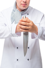 serious cook with a very sharp knife in his hands on a white background