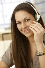 Closeup portrait of woman with headset