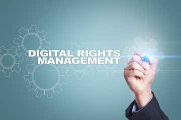 Businessman drawing on virtual screen. digital rights management concept.