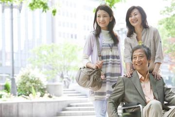 Family standing on sidewalk