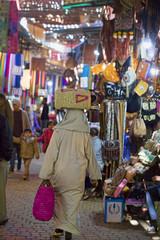 Man carrying bag through streets of Marrakech