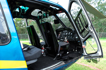 Helicopter interior with open door and operating console