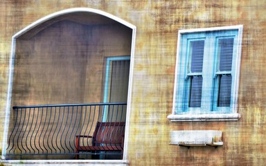 Nice View of a balcony and a window with blue shutters