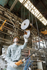 Warehouse Worker Using Pulley