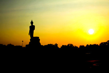 Sunset in Buddhist park in the Phutthamonthon district, Buddhamonthon. Nakhon Pathom Province of Thailand. (Silhouette of Buddha)