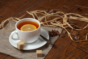 Cup of tea with lemon on a wooden table
