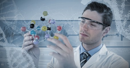 Composite image of scientist experimenting molecule structure