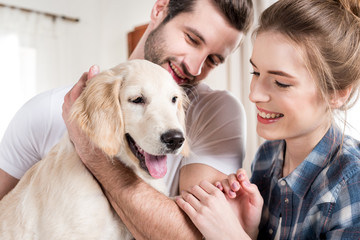 Young couple with puppy