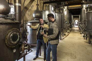People in distillery tasing whiskey
