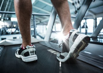Composite image of feet on treadmill with flare