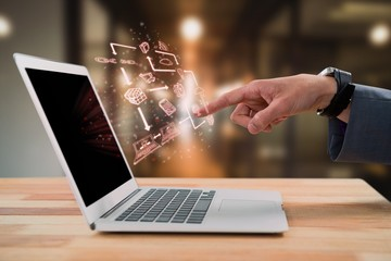 Composite image of businessman gesturing at laptop screen