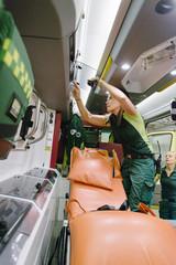 Female paramedics working in ambulance