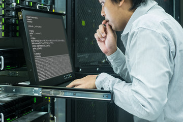 System administrator serious working in data center