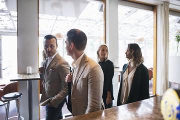 Business colleagues walking in restaurant