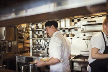 Waiter holding plates at restaurant