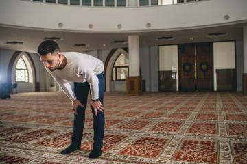 Muslim praying in bow position