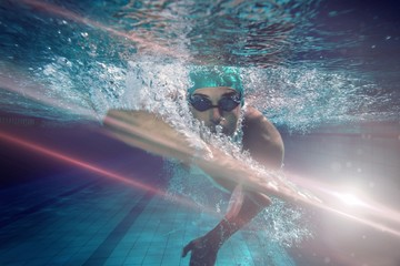 Composite image of fit swimmer training by himself