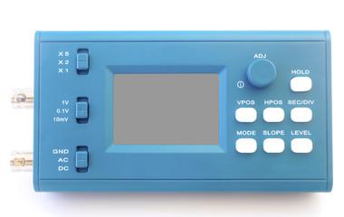 Modern digital signal oscilloscope isolated on white background closeup