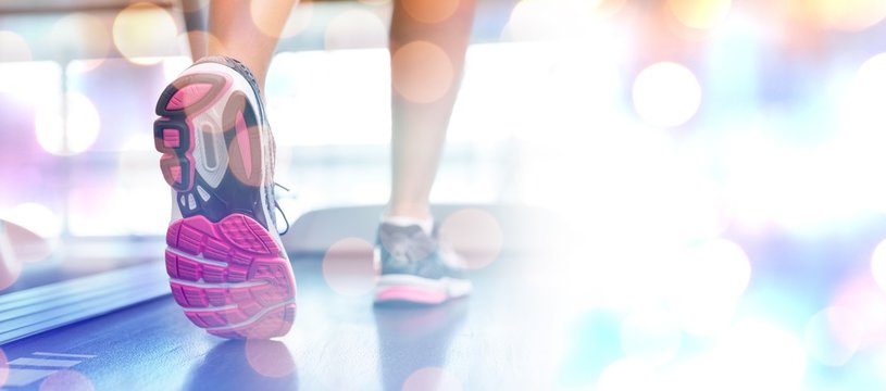 Composite image of womans feet running on the treadmill