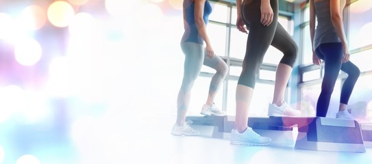 Composite image of three women in aerobics class