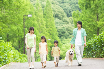Family walking dog