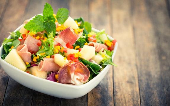 Salad with prosciutto, ham and melon
