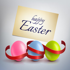 Realistic, colourful Easter eggs with a red ribbon. Greeting car