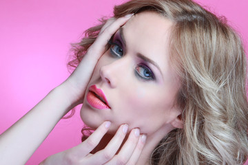 Beauty orange and pink lips in blonde model